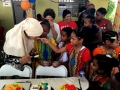 Children-are-feeding-the-mothers-during-cake-cutting-session